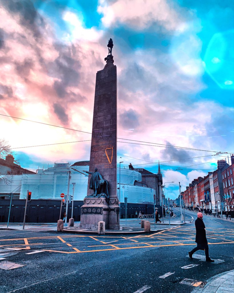 image of a man crossing a street in Dublin