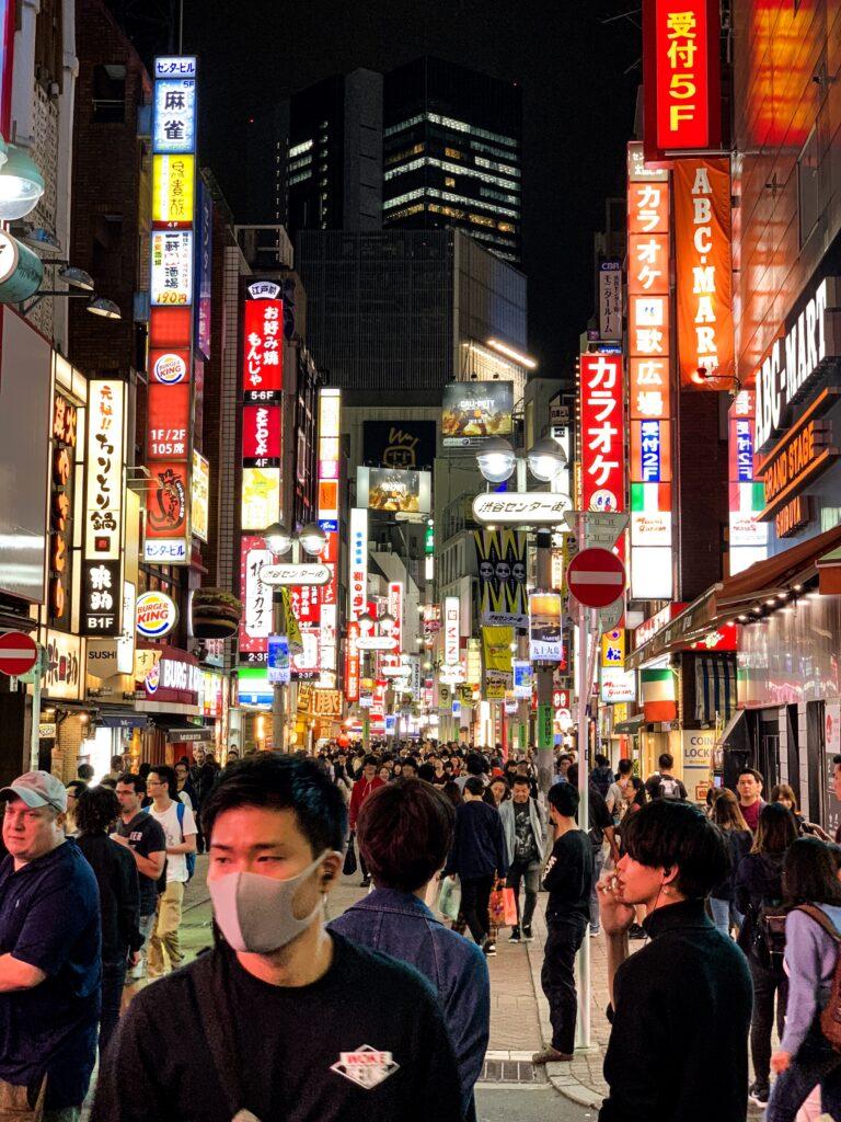 walking through a very crowded Shinjuku